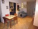 scarperia, in zona tranquilla, appartamento in piccolo condominio composto da ingresso, soggiorno con camino, cucinotto, due camere, servizio oltre ripostiglio, due balconi e garage. ottimo stato.